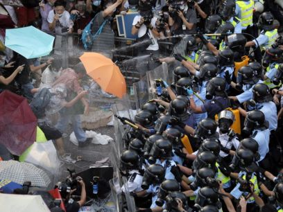 Protesters defend from pepper spray (AP Photo)